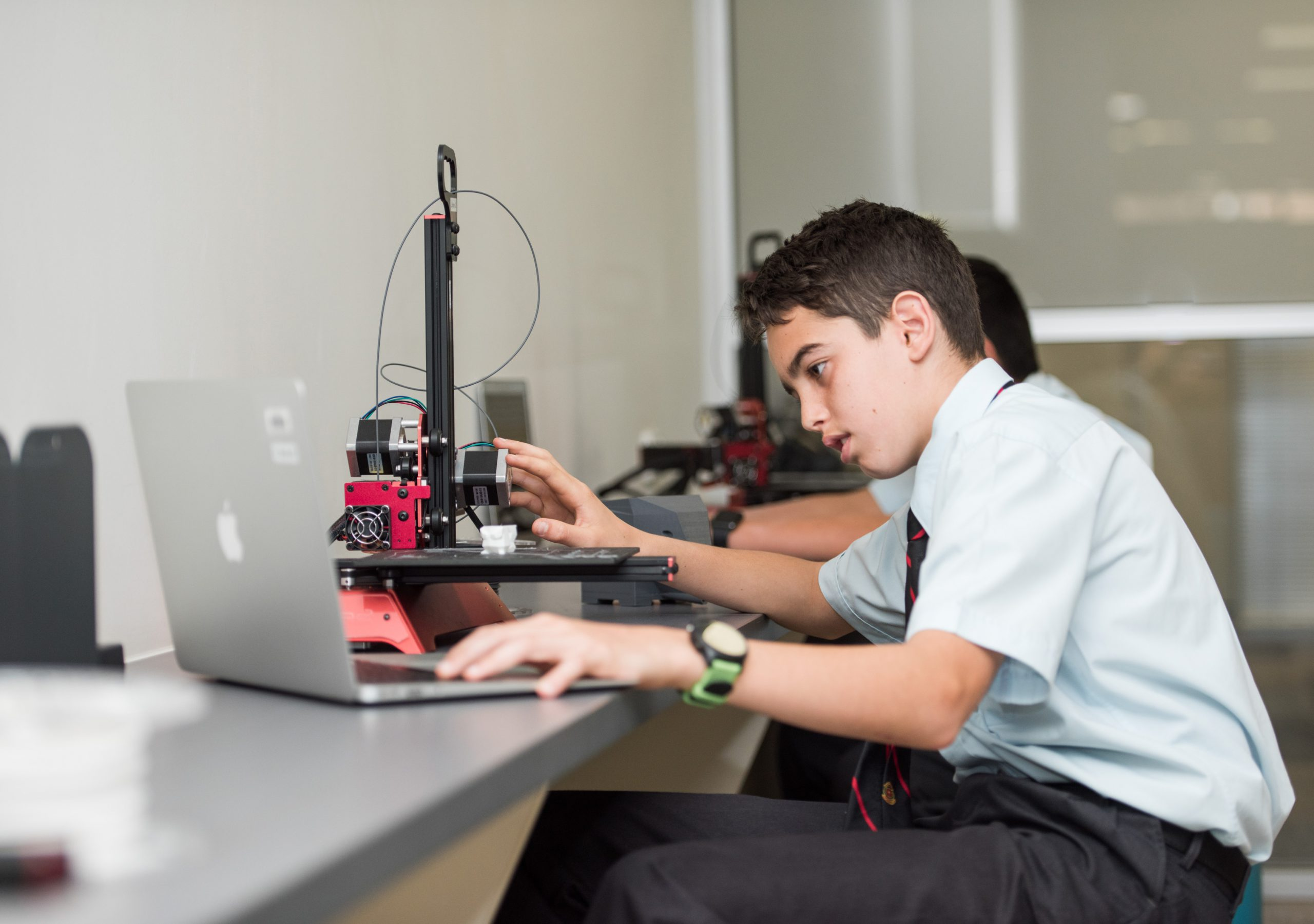 A student focuses on his technology project